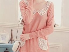 pink sweater with lace collar and pockets