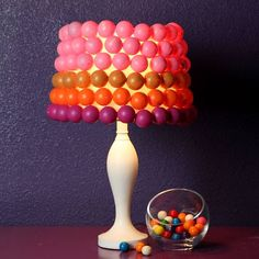 Using colorful balls on a simple tin box you can get this vibrant lamp ready for your room décor.