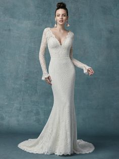 This sleeved boho wedding dress is comprised of allover lace, with sheer lace comprising the long sleeves, bell cuffs, V-back, and V-neckline. Sheath silhouette lined with York jersey for a luxe feel. Finished with covered buttons and zipper closure. Lace  V-back. V-Neckline. Lace illusion long sleeves with bell cuffs. Lined with York jersey for a luxe feel. Covered buttons and zipper closure . Maggie Sottero Wedding Dresses, Wedding Dress Sleeves, Long Sleeve Wedding, Boho Wedding Dress, Dream Wedding Dresses, Designer Wedding Dresses, Bridal Dresses, Wedding Gowns, Mermaid Wedding