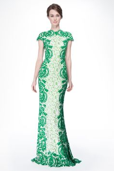 Contrast Lace Cap Sleeve Gown in Green Leaf / Ivory by Tadashi Shoji.  A tonal play of greenleaf and ivory steal the show in this all-over lace evening gown. Hand cut panels of green embroidered lace adorn the gown's sides and trim the shaped neckline, cap sleeves, and hem. Fully lined in our signature stretch jersey lining.