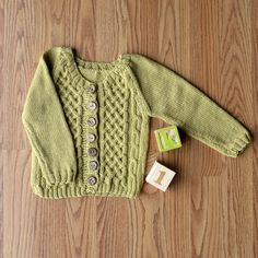 Free Pattern!  The knitted Picket Cardigan in Little Bird.  Adorable!