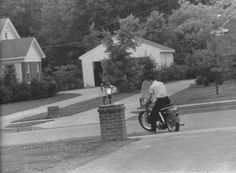 """1034 Audubon Drive - Elvis driving out of the not yet walled or gated driveway - May 1956 Photo by Marvin Israel © Lawrence Israel courtesy """"Elvis Presley 1956"""""""