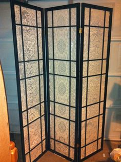 Repurposed japanese screen room divider and old lace tablecloths!