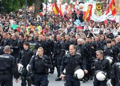 """critical-virtuality: """" German police officers escort an anti-capitalism protest march with some people in Frankfurt, Germany, Saturday, May Read it on Global News: Global Winnipeg"""