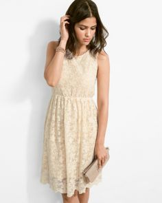 Lace, unlaced  our relaxed and super-easy silhouette gives lace a life beyond the party-dress trope. From its pull-on styling to its tonal lining, this dress has an Indie spirit. And the lining stops short of the scalloped hem for a peek of sheerness just where you'd want it.Front and back scoop neckline Bust and back dartsWaistline has a bit of elastic for giveKnee length, with scalloped hemNylon mesh; knit liningImported