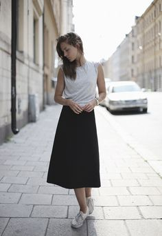 white tee, black midi skirt, white sneakers