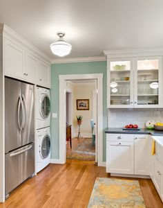 A washer and dryer in a kitchen and it looks good!  There is hope for our w&d/kitchen after all.  This is much better than having it in the basement like a lot of old houses opt for.