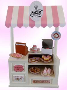 Sized perfectly for 18 inch dolls, such as American Girl ®. Introducing our new bakery shoppe series. Comes with 5 interchangeable signs. This adorable Bakery Shoppe comes with a vintage inspired register with pretend money. Also your doll can now have a shoe and tea shop with our interchangeable signs. Designed and Manufactured by us, The Queen's Treasures ®.