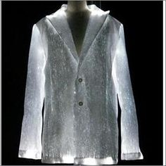 Shiny jacket great for any party! Beautiful light effects Made of optical fiber fabric and cotton Several light colors available Batteries included Operational time up to 30 hours. Inner cotton lining LEDs lifespan more than 50 000 hrs Smart Textiles, E Textiles, Geometric Fashion, Smart Outfit, Sculptural Fashion, Wearable Technology, Future Fashion, Fiber Optic, Cycling Outfit
