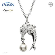 Swarovski® crystals shine with brilliance in this sterling silver cast Dolphin pendant featuring a Swarovski created pearl. Ocean Jewelry, Dolphin Jewelry, Antique Jewelry, Silver Jewelry, Dreamland Jewelry, Best Jewelry Stores, Jewelry Companies, Pearl Pendant, Jewelry Crafts