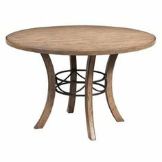 """Round mango wood dining table with a forged iron accent.  Product: Dining tableConstruction Material: Mango solid wood and forged ironColor: Antique walnutFeatures:     Sandblasted for rustic appeal    Corner braced legs with oversized bolts     Dimensions: 30"""" H x 48"""" Diameter      Assembly: Easy assembly required"""