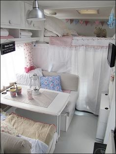 over-cab bed, white curtain wall hiding driver/passenger seats ...Anyone Can Decorate: Camping in Vintage Chic Style