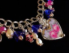 Broken china jewelry heart charm bracelet by Dishfunctional Designs