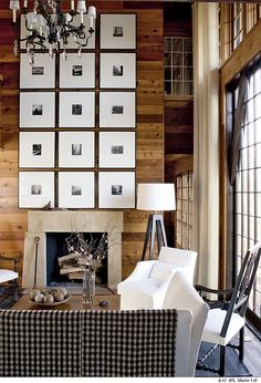Gallery walls are a popular trend and this home via Atlanta Homes and Lifestyles takes it a step further with a BIG impact.