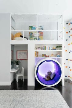 Playtime has never looked as much fun as it does in this contemporary playroom. A play loft is reachable via ladder or climbing wall, with a net to keep little ones safe. A reading nook features an LED light strip that kids can set to whatever color they want. A wall of storage shelves houses a TV and helps keep toys organized.
