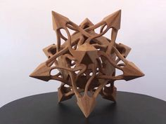 This wooden stellated dodecahedron sculpture is math art at its best. The points of the figure correspond to vertices of icosahedron, one of Platonic solids. Wooden Statues, Wooden Figurines, Wooden Art, Wooden Decor, Wood Carving Designs, Wood Carving Patterns, Cardboard Sculpture, Wood Sculpture, Woodworking Wood