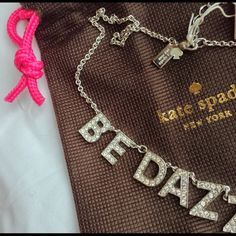 """NWT Kate Spade Be Dazzling Crystal Necklace HOST PICK Brand New. Never been worn. Kate Spade New York """"Be Dazzling"""" 16 inch Rhodium Plated Necklace with lobster claw closure. Sparkling pave letters, all crystals are present. Comes with Kate Spade dust bag. Please feel free to ask questions before buying. trades paypal kate spade Jewelry Necklaces"""