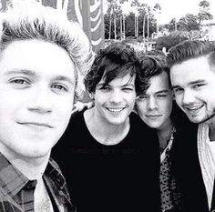 Their so cute! Taking a selfie.  Harry's eyes = blinking