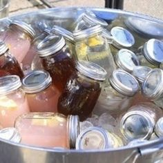 Mason jars pre-filled with water, pink lemonade, and sweet tea for wedding drink station. See more drink station ideas at https://www.buzzfeed.com/emofly/cute-party-drink-stations