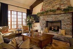 Stone fireplace, wood beam mantle