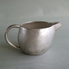 // Small pitcher: Pottery, silver glaze, Kiyosumi Babaghuri shop.
