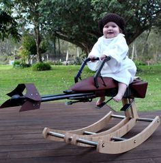 """This geeky dad handmade a Star Wars rocking chair for his 1-year-old daughter, and he won every heart in the galaxy. (It even has """"laser"""" blasters!)"""