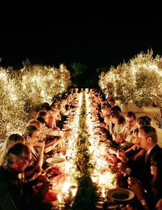 Lots of simple, white candles on the tables