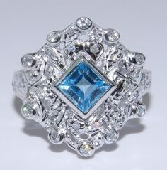 Estate Vintage 14K White Gold Diamond & Blue Topaz Unique Ring. $489.00, via Etsy.