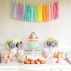 Last week we celebrated little Sophia's 4th birthday party with a pastel-inspired unicorn party. It was a magical day with unicorns flying all over the show. The table was decorated in pastel rainbow shades with a naked layer cake with the cutest ever unicorn topper! Hydrangeas, unicorn cupcakes and sweets sat prettily on a white ornate table with a white backdrop and tassel garland. Hello there cutey pie! Don't you just want to squish those cheeks! Magical milkshakes for magical u...