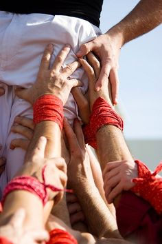Fent pinya - Castellers  Human castles is traditional activity in Catalonia and the beauty of it is that people ranging from light children to strong large adults, men but also some women, all must contribute to the building of a multilayer human castle. One fails, the group fails. If the castle can be completed is a collective achievement.