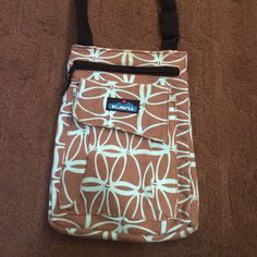 Kavu purse handbag, cross body Kavu cross body purse. Very trendy. I purchased on Posh, and it is too small for me. Good condition, no holes or tears inside or out. Corners of outer pocket tend to turn up slightly. Long, adjustable black strap. Two separate pockets on front: one zipper pocket, one Velcro pocket. Additional Velcro pocket on back. Purse opening has snap closure. See pics for size, pics with ruler. Thanks for looking!  Kavu Bags Crossbody Bags