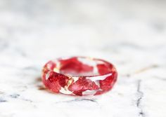 Hey, I found this really awesome Etsy listing at https://www.etsy.com/listing/246176841/eco-resin-ring-with-natural-pressed-red