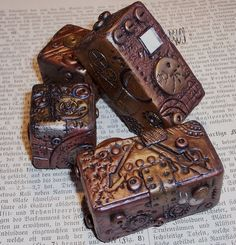 these are steampunk blocks, but I could see myself covering altoid tins and making them into steampunk treasure boxes!!!