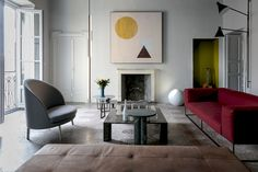 Living Room: Project, Lamp_Urano, Table accessories_Omaggio a Morandi by Elisa Ossino for Salvatori; Table_'Love Me,Love Me Not' in Noir Saint Laurent  and Verde Alpi marble, by Michael Anastassiades  for Salvatori; Table_Dritto Coffee by Piero Lissoni for Salvatori; Armchair_Jim by Artflex, Sofa by Piero Lissoni for  Living Divani, Panca Track by David Lopez Quincoces for Living Divani, wall paint by File Under Pop.