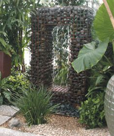 Gabion Water Fountain   Consider the gabion. Originally used as erosion control and in retaining walls, the attractive look of rocks encased in wire mesh has spread from candleholders to chaise lounges to sculptural elements like this fountain by Yard Art