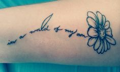 "Alice in wonderland tattoo. ""In a world of my own."""