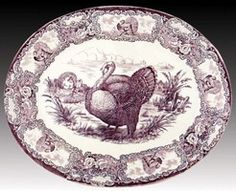 A Thanksgiving Tom Turkey platter, purple transfer printed in a meadow scene with rim decorated with ten vignettes of turkeys and floral bouquets. Mark: Purple backstamp encased diamond mark R & M, below Staffordshire England. Circa 1893 to 1914.