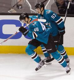San Jose Sharks forwards Tomas Hertl and Tommy Wingels celebrate Hertls first period goal (Nov. 28, 2015).