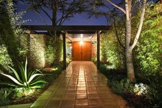 Contemporary Exterior of Home with Trellis, exterior terracotta tile floors, Pathway, Fence, exterior tile floors