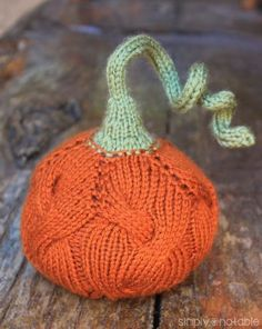Knit plump cabled pumpkins for your fall decor with this free knit pumpkin pattern from Mom of Simply Notable