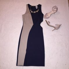 Gracie Size M navy blue/tan dress Navy Blue/Tan cutout dress. Front angle slit. Tag says size Medium but it does run small. Very cute for a date night! I labeled it as a small because it does run small. Gracie Dresses Midi
