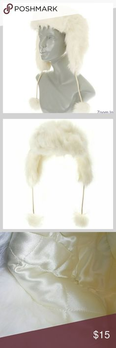 Fuax Fur Trappers Hat It's a winter wonderland with our soft trapper ski hat. Soft white faux fur hat features a satin-soft interior and pom pom ends.  Material: Polyester Claire's Accessories Hats