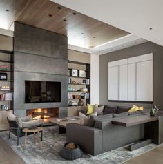 A blackened steel fireplace wall completed by Mayer Designs, Inc. gives a sleek finish to this living room. #luxePNW
