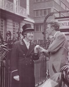 John Lennon and Peter Cook.Shot on 27/11/66 in Broadwick Street, Soho.