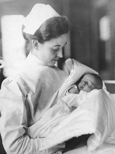 Newborn baby boy Lucien P. Smith Jr in the arms of a nurse, November 1912. Smith's mother, Eloise Hughes Smith (1893 - 1940), was pregnant while a passenger returning from her honeymoon on board the White Star liner Titanic when the ship sank on 15th April 1912