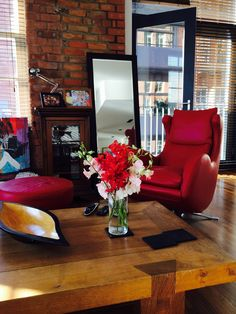 Seriously stylish - Ferrari red leather swivel chair with matching round footstool.
