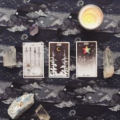 image via @fancyjaime  three card reading, the wild unknown, past present future, candle, crystal