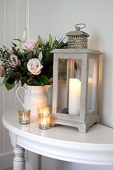 Small hallway decorating · grey storm lantern + candles but with other type of flowers - for centerpiece flat hallway Ideas Actuales, Cool Ideas, Gift Ideas, Decor Ideas, Small Hallway Decorating, Storm Lantern, Entry Tables, Entrance Table, Grey Hallway