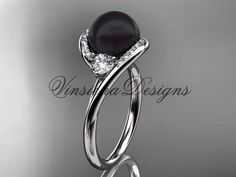 Beautiful in every given way, this diamond engagement ring is made of solid 14kt white gold, with 9mm Tahitian Black Cultured Pearl center stone, perfectly set in a stunning 14kt white gold band. It h