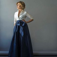 Giving the illusion of a two piece outfit, a soft taffeta top flows elegantly into a high low ball skirt.